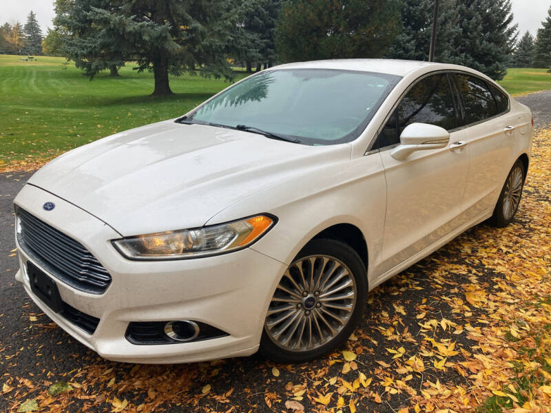 2015 Ford Fusion for sale at BELOW BOOK AUTO SALES in Idaho Falls ID