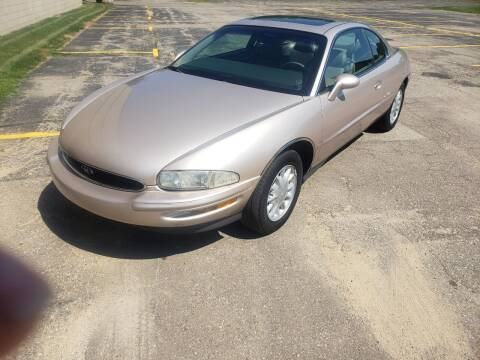 1995 Buick Riviera for sale at Caruzin Motors in Flint MI