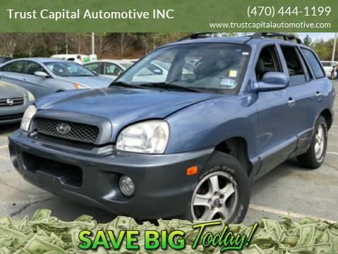 2002 Hyundai Santa Fe for sale at Trust Capital Automotive Inc. in Covington GA