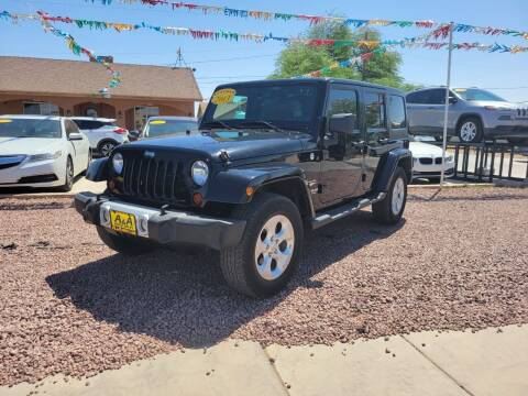 2013 Jeep Wrangler Unlimited for sale at A AND A AUTO SALES in Gadsden AZ