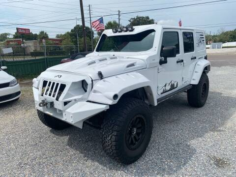 2016 Jeep Wrangler Unlimited for sale at Velocity Autos in Winter Park FL