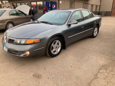2004 Pontiac Bonneville for sale at COUNTRYSIDE AUTO INC in Austin MN