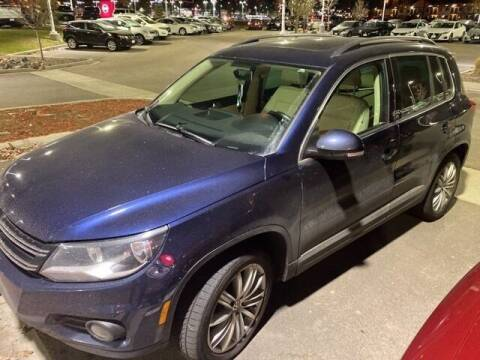 2013 Volkswagen Tiguan for sale at EMPIRE LAKEWOOD NISSAN in Lakewood CO