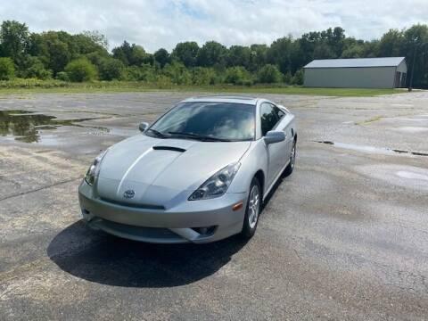 2003 Toyota Celica for sale at Caruzin Motors in Flint MI