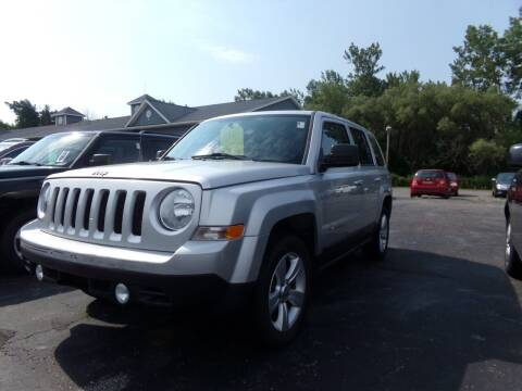 2013 Jeep Patriot for sale at Pool Auto Sales Inc in Spencerport NY