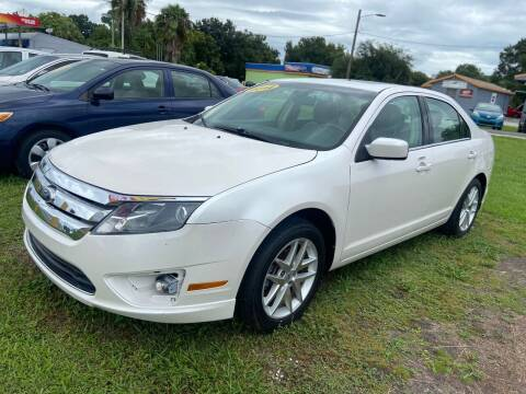 2012 Ford Fusion for sale at Unique Motor Sport Sales in Kissimmee FL