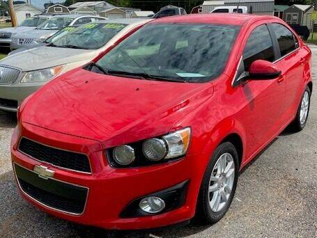 2014 Chevrolet Sonic for sale at Britton Automotive Group in Loganville GA