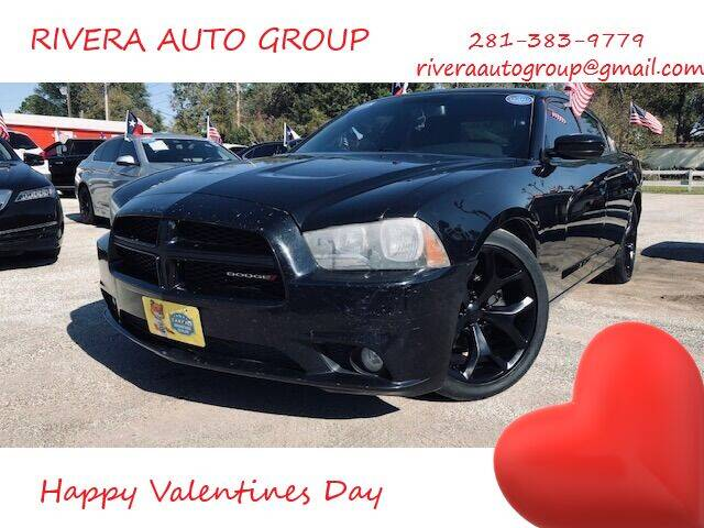 2013 Dodge Charger for sale at Rivera Auto Group in Spring TX