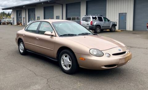 1997 Ford Taurus for sale at DASH AUTO SALES LLC in Salem OR