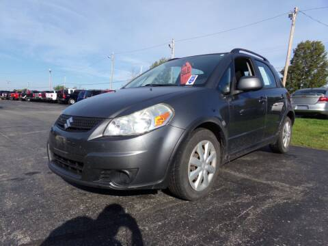 2011 Suzuki SX4 Crossover for sale at Pool Auto Sales Inc in Spencerport NY