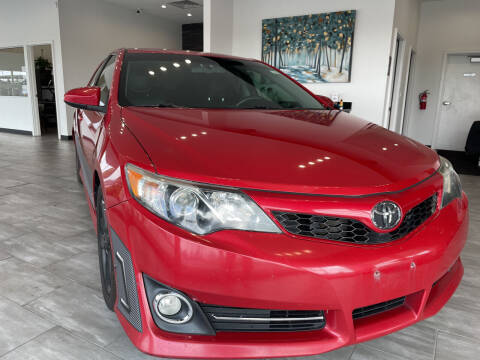 2012 Toyota Camry for sale at Evolution Autos in Whiteland IN