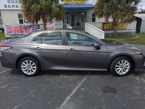 2020 Toyota Camry for sale at Sun Coast City Auto Sales in Mobile AL