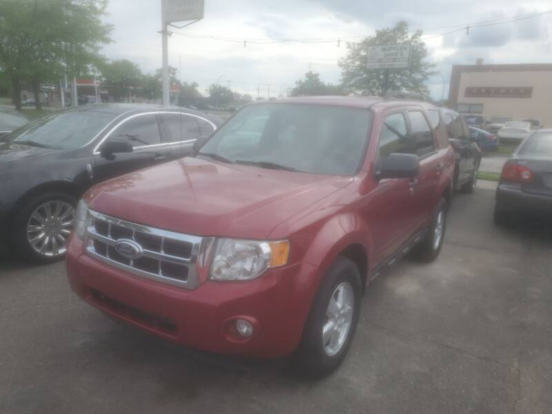 2010 Ford Escape for sale at J & J Used Cars inc in Wayne MI