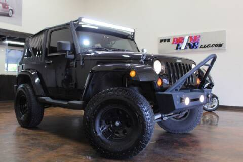2013 Jeep Wrangler for sale at Driveline LLC in Jacksonville FL