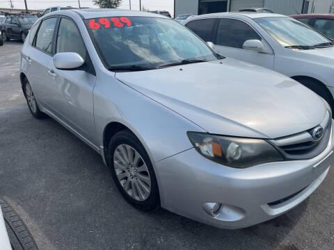 2011 Subaru Impreza for sale at BELOW BOOK AUTO SALES in Idaho Falls ID