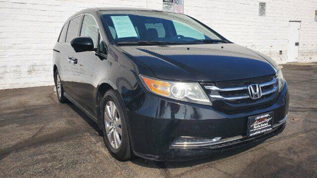 2014 Honda Odyssey for sale at ADVANTAGE AUTO SALES INC in Bell CA