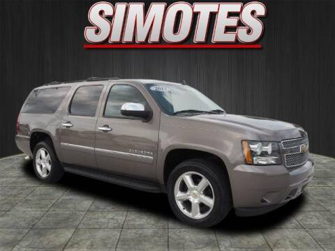 2011 Chevrolet Suburban for sale at SIMOTES MOTORS in Minooka IL