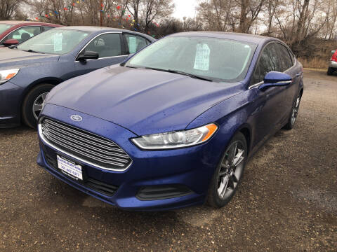 2016 Ford Fusion for sale at BARNES AUTO SALES in Mandan ND