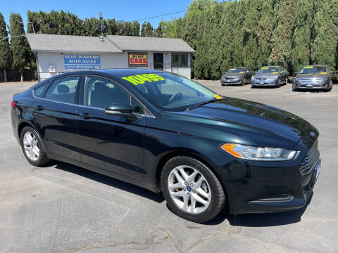 2014 Ford Fusion for sale at Blue Diamond Auto Sales in Ceres CA