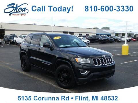 2014 Jeep Grand Cherokee for sale at Erick's Used Car Factory in Flint MI