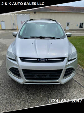 2013 Ford Escape for sale at J & K AUTO SALES LLC in Holland MI
