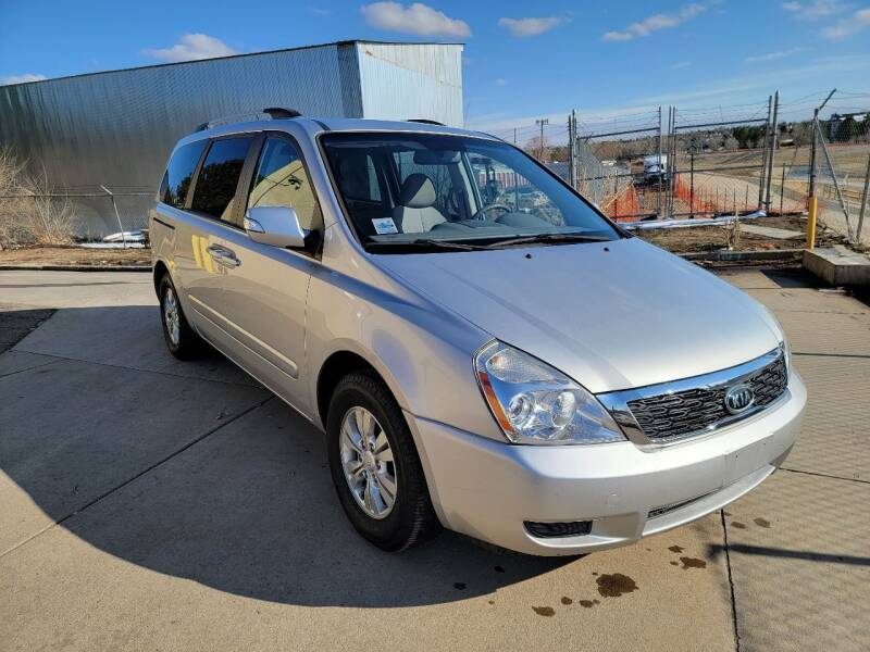 2012 Kia Sedona for sale at Red Rock's Autos in Denver CO
