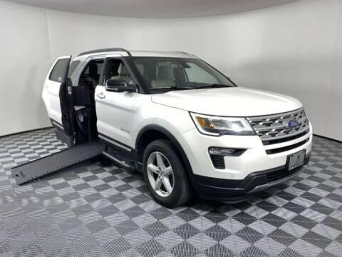 2018 Ford Explorer for sale at AMS Vans in Tucker GA