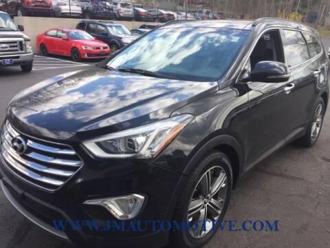 2014 Hyundai Santa Fe for sale at J & M Automotive in Naugatuck CT
