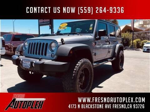 2014 Jeep Wrangler Unlimited for sale at Carros Usados Fresno in Fresno CA