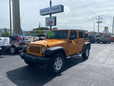 2012 Jeep Wrangler Unlimited for sale at Used Car Factory Sales & Service in Bradenton FL