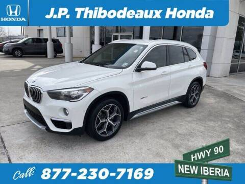 2016 BMW X1 for sale at J P Thibodeaux Used Cars in New Iberia LA