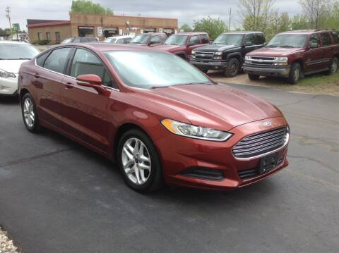2014 Ford Fusion for sale at Bruns & Sons Auto in Plover WI