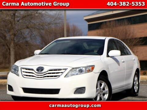 2011 Toyota Camry for sale at Carma Auto Group in Duluth GA