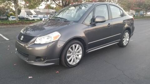 2012 Suzuki SX4 for sale at Car Guys in Kent WA