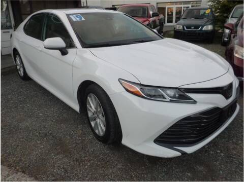 2019 Toyota Camry for sale at Klean Carz in Seattle WA