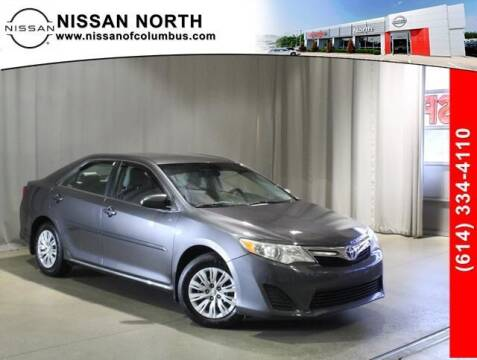 2014 Toyota Camry for sale at Auto Center of Columbus in Columbus OH