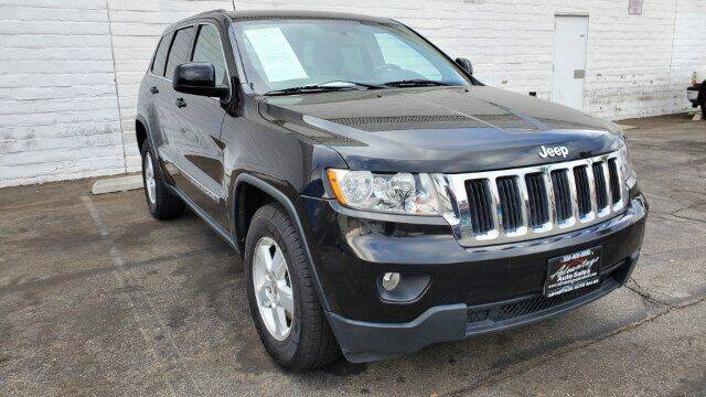 2013 Jeep Grand Cherokee for sale at ADVANTAGE AUTO SALES INC in Bell CA