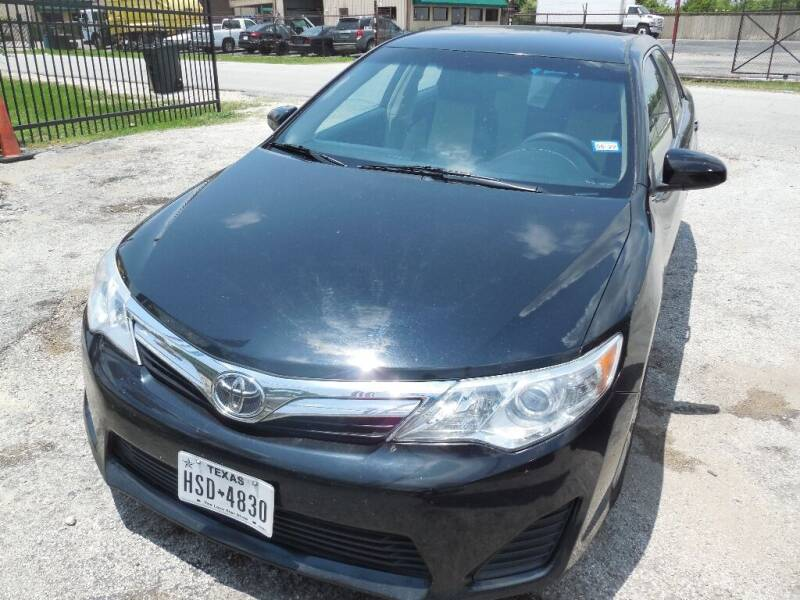 2012 Toyota Camry for sale at SCOTT HARRISON MOTOR CO in Houston TX