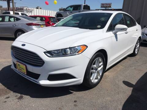 2014 Ford Fusion for sale at New Wave Auto Brokers & Sales in Denver CO