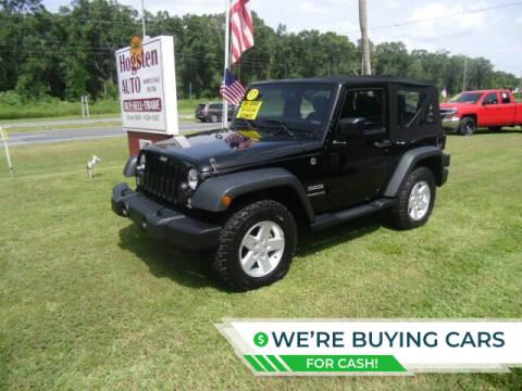 2017 Jeep Wrangler for sale at HOGSTEN AUTO WHOLESALE in Ocala FL