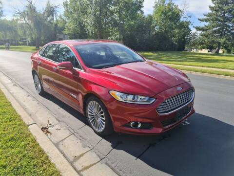 2013 Ford Fusion Hybrid for sale at A.I. Monroe Auto Sales in Bountiful UT