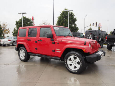 2012 Jeep Wrangler Unlimited for sale at SIMOTES MOTORS in Minooka IL
