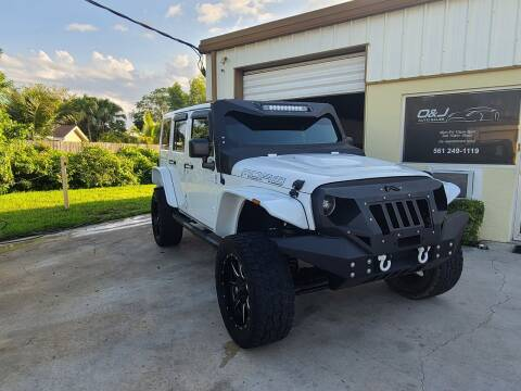 2013 Jeep Wrangler Unlimited for sale at O & J Auto Sales in Royal Palm Beach FL