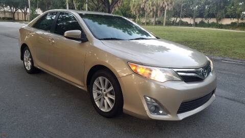 2012 Toyota Camry for sale at DELRAY AUTO MALL in Delray Beach FL