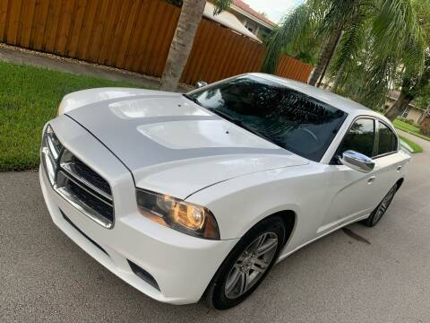 2014 Dodge Charger for sale at FINANCIAL CLAIMS & SERVICING INC in Hollywood FL