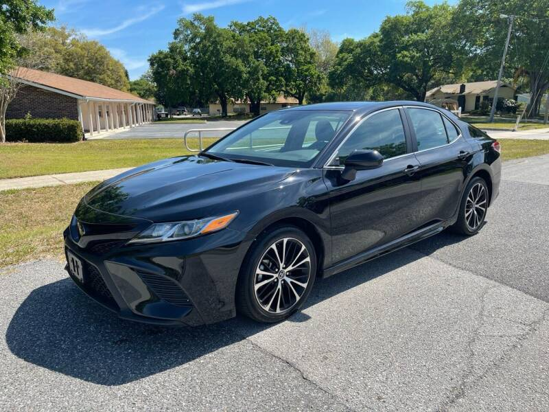 2019 Toyota Camry for sale at P J Auto Trading Inc in Orlando FL