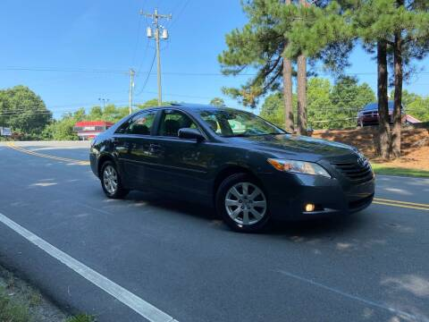 2009 Toyota Camry for sale at THE AUTO FINDERS in Durham NC