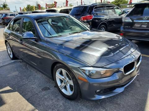 2014 BMW 3 Series for sale at America Auto Wholesale Inc in Miami FL