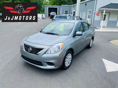 2014 Nissan Versa for sale at J & J MOTORS in New Milford CT