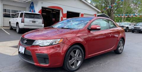 2010 Kia Forte Koup for sale at Hensley Auto Group in Middletown OH